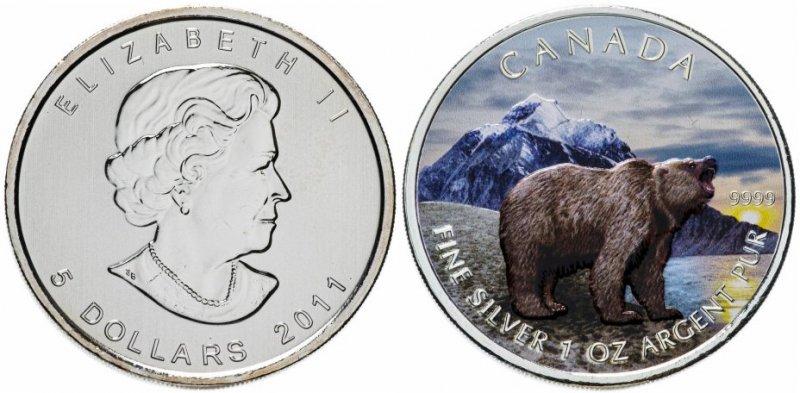 «Бурый медведь», серия «Дикая фауна Канады». Канада, 5 долларов, 2011 год. На денежном знаке изображен рычащий зверь на фоне гор, неба и солнца