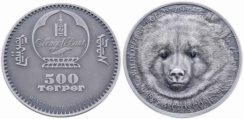 «Медведь гоби», серия «Фауна», 500 тугриков. Монголия, 2019 год. На денежном знаке отчеканена голова медведя с глазами-кристаллами черного цвета