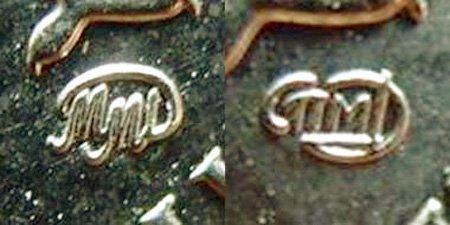 Логотипы ММД (слева) и СПМД (справа) на российских монетах современной чеканки