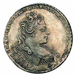 Монета, покрытая лаком