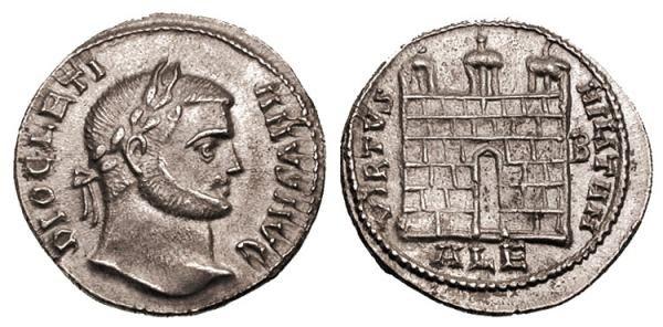 Император Диоклетин (284-306). Аверс: император смотрит вправо, на его голове лавровый венок. Реверс: VIRTVS MILITVM. Изображены ворота лагеря с тремя башнями. Вес монеты 3,34 г.