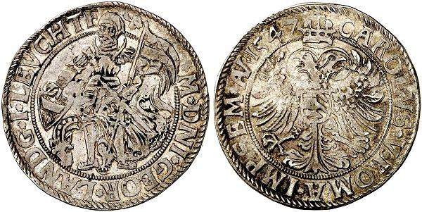 1\2 талера 1547 год. Георг III, ландграф Лейхтенбергский, вассал императора Священной Римской империи Карла V. На аверсе - имперский герб и императорский титул. На реверсе – Георг, с полученным от императора знаменем