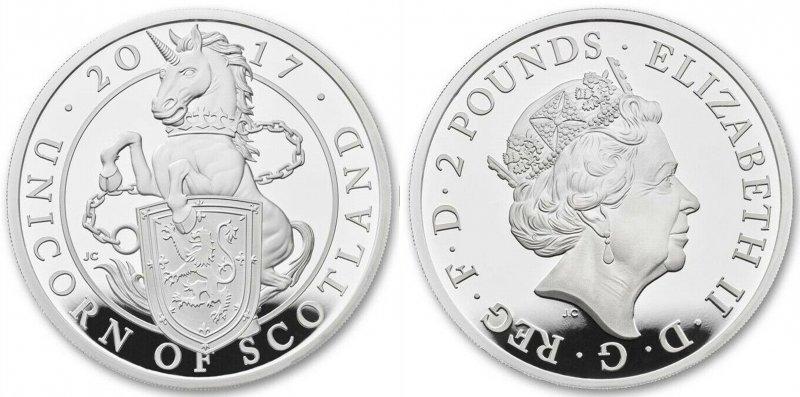 Серебряная монета 2 фунта. Единорог держит щит с изображением исторического Королевского герба Шотландии: восстающего красного льва. Единорог изображён в цепях, с короной, надетой на шею. Это может быть трактовано, как символ зависимости Шотландии от Англии