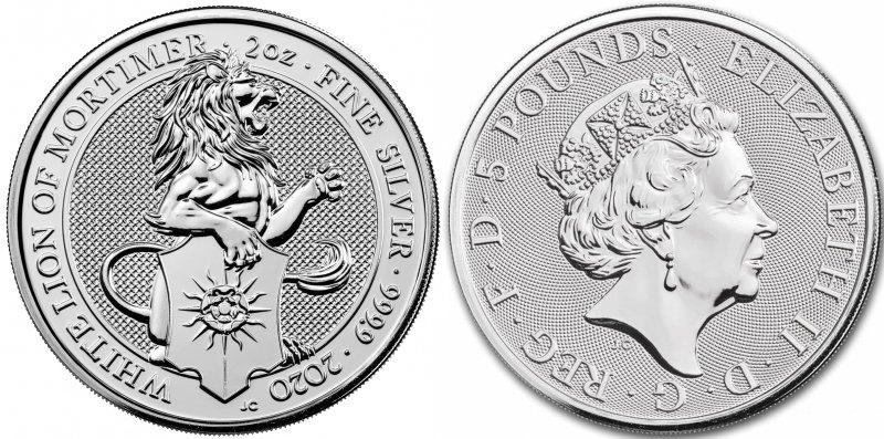 Серебряная монета 5 фунтов. Лев держит щит, на котором изображена белая роза Йорка с золотыми лучами солнца – символ, принятый Эдуардом IV, который считал солнце знаком удачи в битве