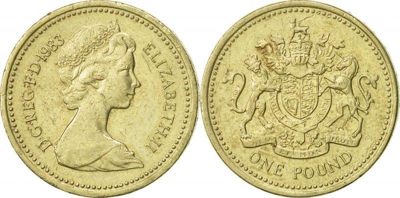 Однофунтовая монета выпуска 1983 года. На реверсе изображён Королевский герб (автор Эрик Сьюэлл). Монеты с таким реверсом чеканились в 1983, 1993, 1998, 2003 и 2008 годах. На гурте отчеканено латинское выражение «DECUS ET TUTAMEN» («Украшение и защита»). Такой девиз впервые появился на гурте монет из драгоценных металлов в 1662 году и должен быт стать не только их украшением, но и защитить края монеты от обрезки – умышленной порчи стоимости монеты