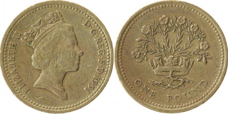 Однофунтовая монета 1991 года, посвященная Северной Ирландии. Чеканилась в 1986 и 1991 годах. На гурте – латинское выражение «DECUS ET TUTAMEN» («Украшение и защита»)
