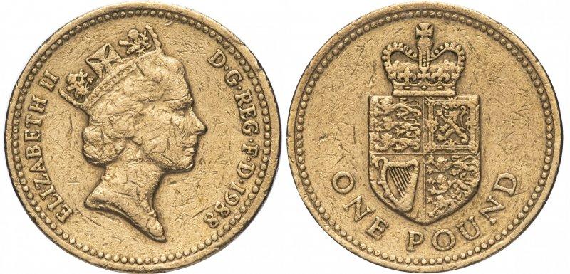 Однофунтовая монета 1988 года с Королевским гербом на реверсе. Чеканилась в 1988 году. На гурте – латинское выражение «DECUS ET TUTAMEN» («Украшение и защита»)