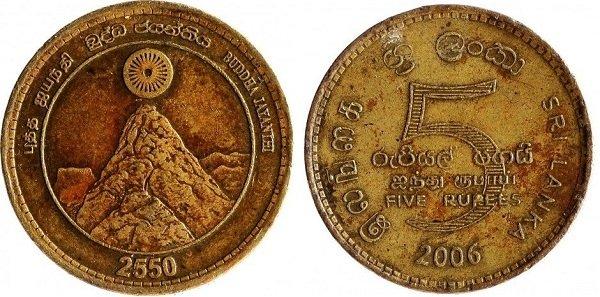 Колесо Дхармы над священной горой Меру на монете номиналом 5 рупий, выпущенной к 2550-летию Будды. Шри Ланка. 2006 год. Сталь с латунным покрытием